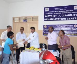 DISTRIBUTION-OF-TRI-CYCLES-BY-HON'BLE-MINISTER-DR.M.B.PATIL_...jpg